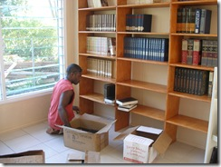 Alick unpacking the books