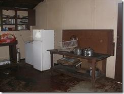 new chest freezer in corner, school refrig but no stove