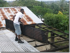 Job pulling off the iron roofing
