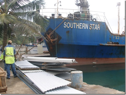MV Southern Star loading to go to Futuna, metal roofing in foreground