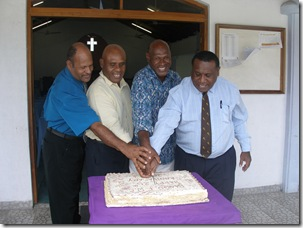 Cutting the anniversary cake at Pango AG. Pastor Berry is on the right side.