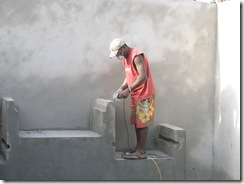Alick sanding the cement work