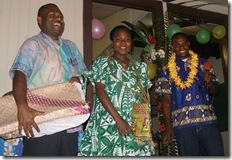 Dean of Students Philip Naias and wife Sarah, receiving gifts from Elivis