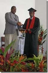Principal Edgell Iolopua and graduate Job Dalili Emele