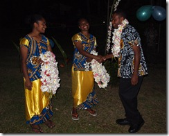 Nicole & Vaily greeting grads with  leis